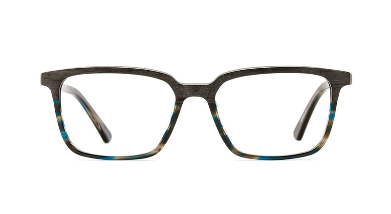 Matte black top half blue tortoiseshell bottom half, squared shape. Available from Chichester opticians, North.