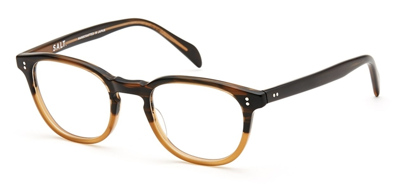 Round frame with keyhole bridge, dark brown on top and pale coffee colour below. Available from Chichester opticians, North.