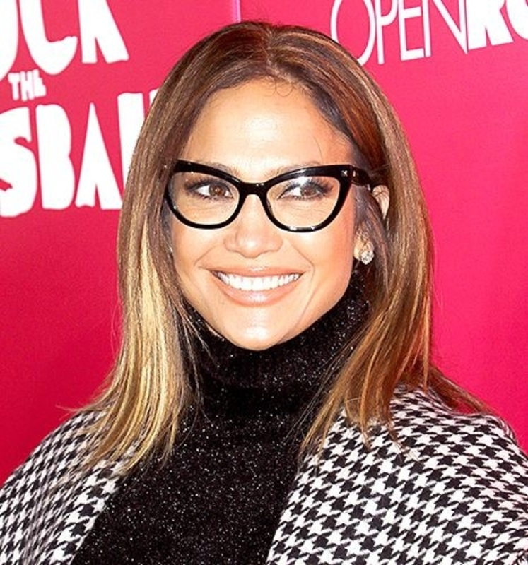 Jennifer Lopez wearing black cat eye glasses